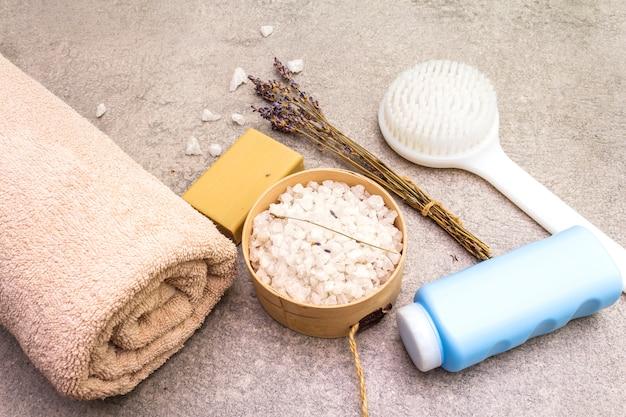Bath towel, sea salt with lavender, natural olive soap, shower gel and brush