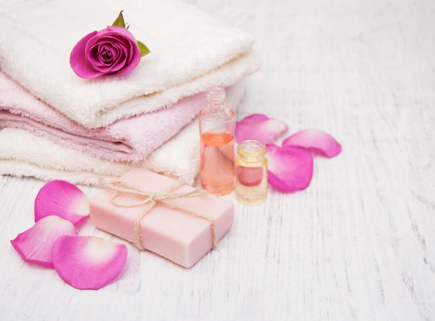 Bath towels,  soap with pink roses