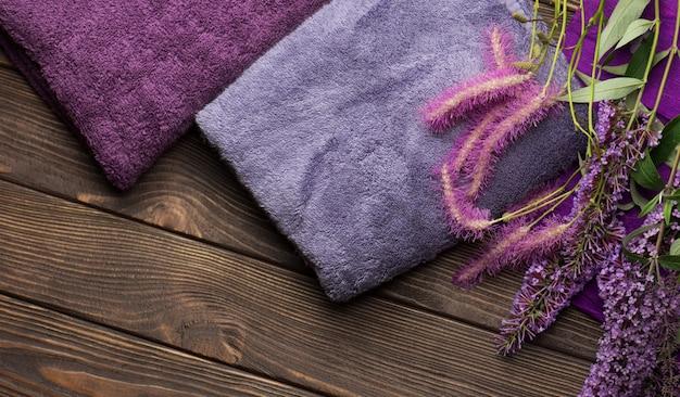 Bath towels on wooden. blue and purple bath towel