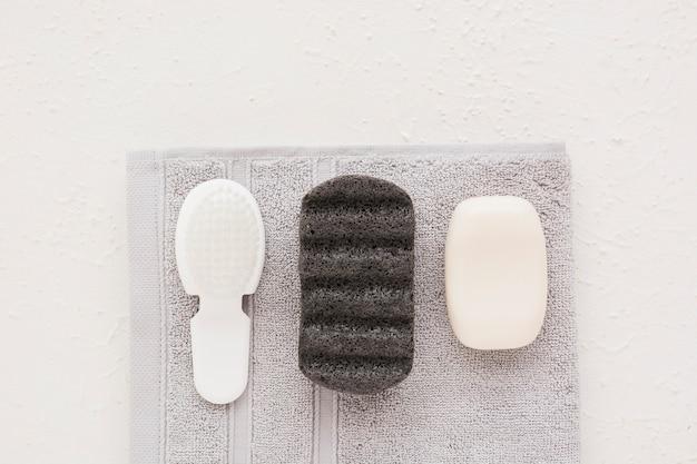 Bath ustensils on towel