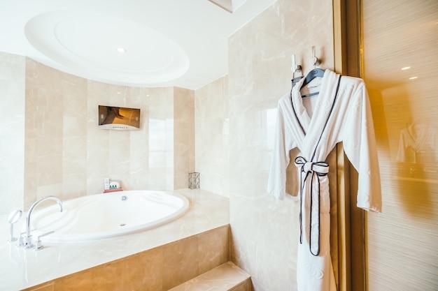 Bathrobe next to a modern bathtub
