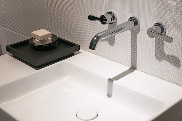 Bathroom interior with sink and faucet, modern design of bathroom,