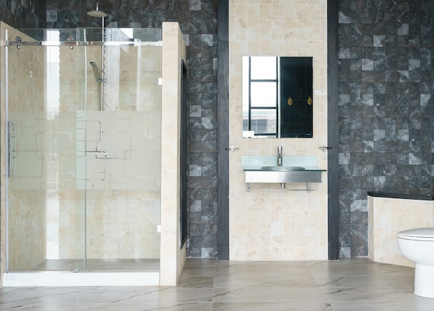 Bathroom interior with white walls, a shower cabin with glass wall