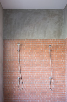 Bathroom outdoor for gym or athlete with nice brick wall and two faucet