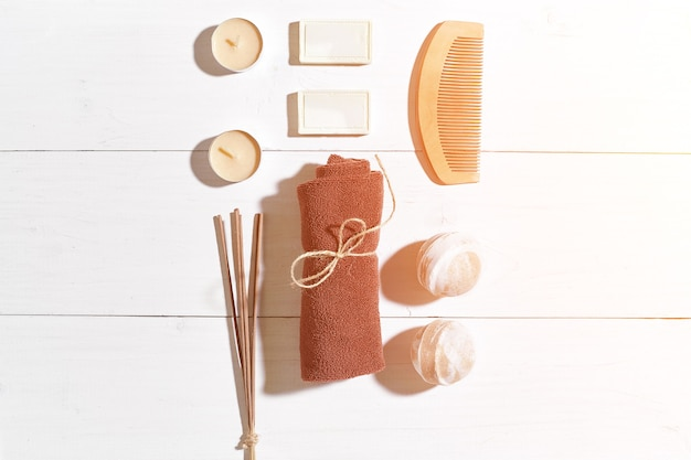 Bathroom or spa set on white background top view mock-up. copy space. still life. flat lay. sun flare