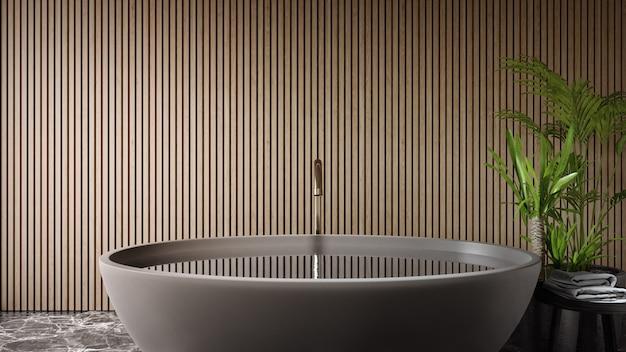 Bathtub on black marble floor of large bathroom in modern house or luxury villa