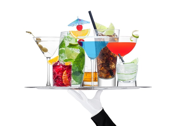 Batler waiter wearing white glove tray with various cocktails with ice isolated on white background.blue lagoon, martini, negroni, mojito, spritz, gimlet, cuba libre, cosmopolitan, margarita.