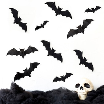 Bats flying over skull