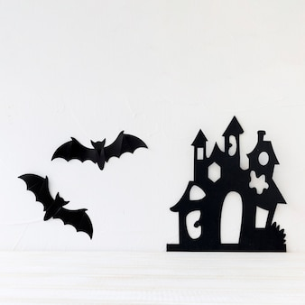Bats and paper castle on wall