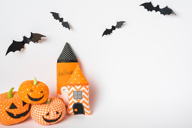 Bats over toy towers and jack-o-lanterns