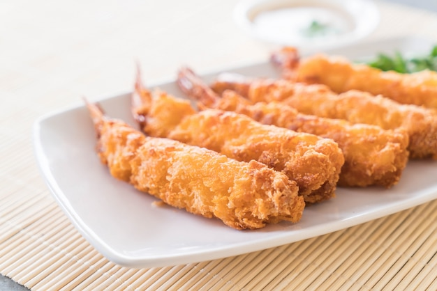 Batter-fried prawns on table