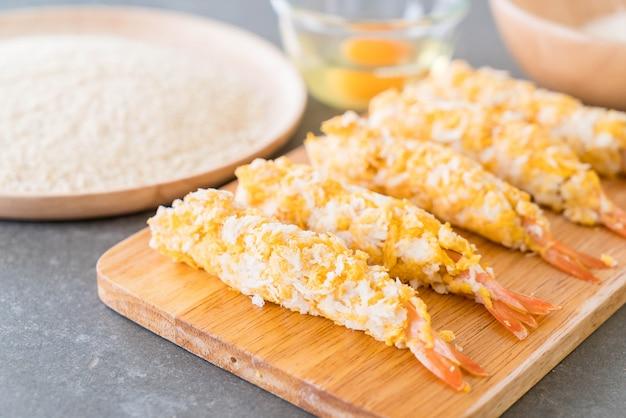Batter-fried prawns on wood board