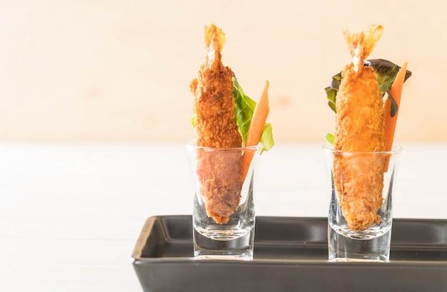 Batter-fried prawns on wood