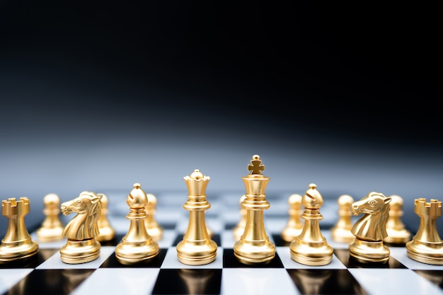The battle chess on chess board.business leader concept for market target strategy.