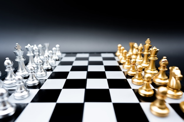 The battle chess on chess board.business leader concept for market target strategy