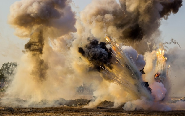 The battlefield with explosions of shells and bombs, smoke