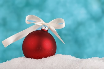 Baubles on white snow