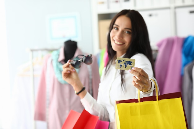 Bauty woman holding plastic credit card