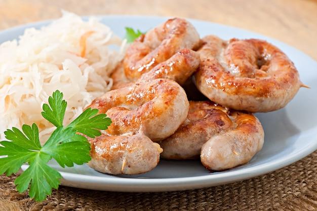 Bavarian fried sausages on sauerkraut