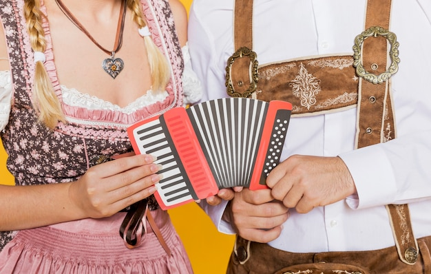 Bavarian friends holding accordion
