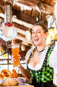 Bavarian woman drinking wheat beer