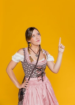 Bavarian woman pointing up