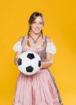 Bavarian young woman holding football