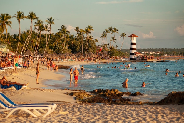 Bayahibe, dominican republic 13 december 2019: bayahibe beach at sunset with tourists