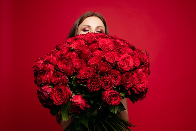 Bbouquet of red roses in hands of woman