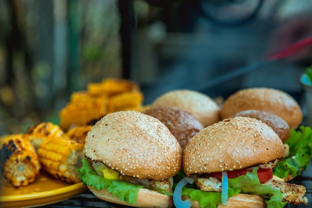Bbq burgers breast with vegetables on the hot charcoal grill