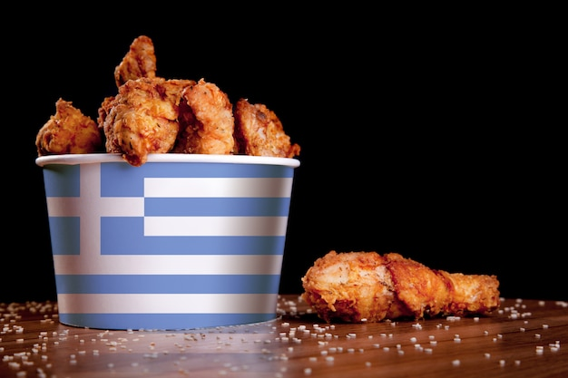 Bbq chicken legs in white bucket