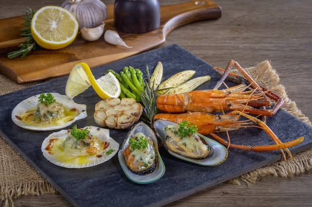Bbq seafood and vegetables on the chopping board