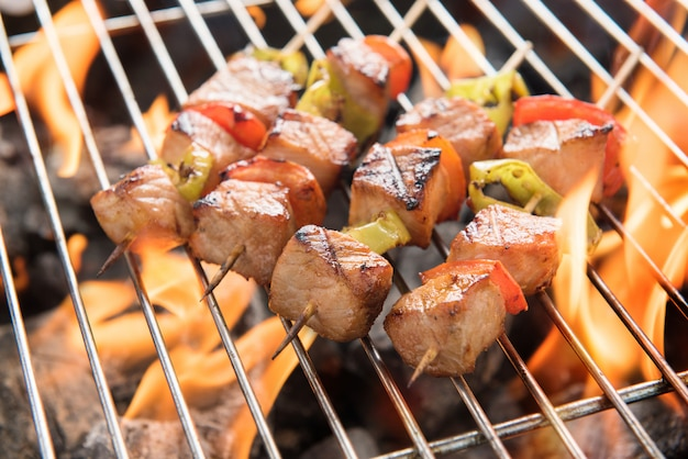 Bbq with cooking. coal grill of chicken meat and peppers