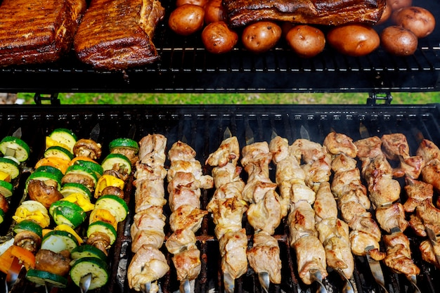 Bbq with kebab cooking coal grill of chicken meat skewers with mushroom and peppers barbecuing dinner