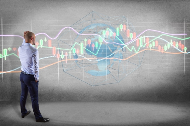 Bbusinessman in front of a wall with a 3d render stock exchange trading data information display