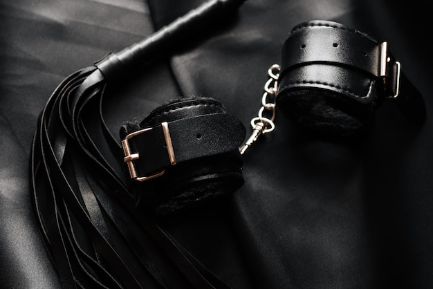 Bdsm sex toys for domination and submission, leather whip and handcuffs