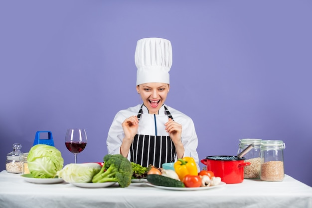 Be all you can be. happy chef cooking vegetables. healthy food and diet. woman housewife in cook hat and apron. fresh preparing. full of vitamin. natural and organic. restaurant kitchen lifestyle.