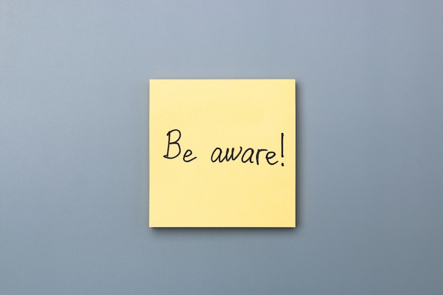 Be aware on yellow sticky note . april fools day