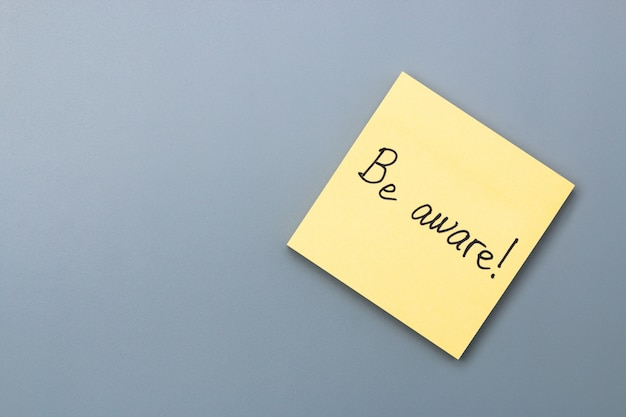 Be aware on yellow sticky note. april fools day