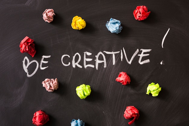 Be creativity word with colorful crumpled paper ball on blackboard