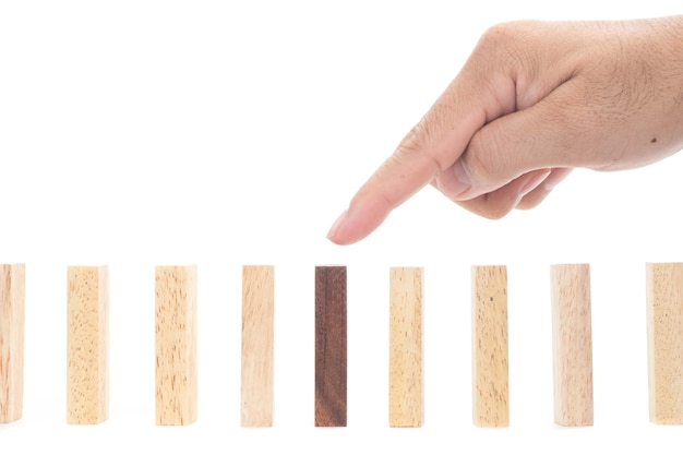 Be different concept. wooden blocks and a hand on white background,