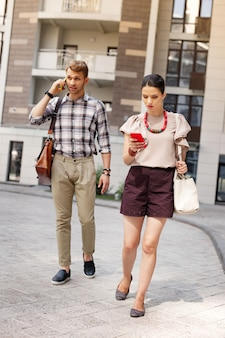 Not to be late. nice busy couple walking together while hurrying to work