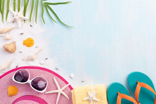 Beach accessories on blue background for summer concept