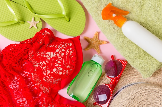 Beach accessories on a colored background