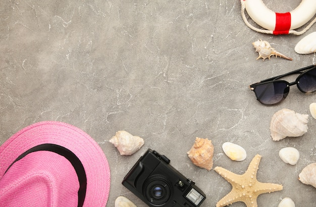 Beach accessories on grey concrete background with copy space