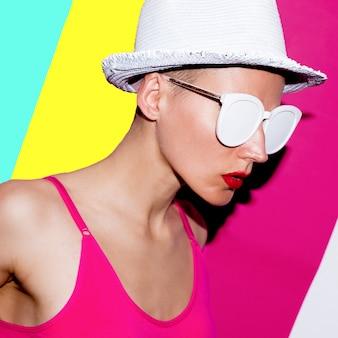 Beach accessories minimal hat and sunglasses. model pop art fashion