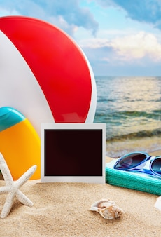 Beach accessories and photos on the memory on a background of sea