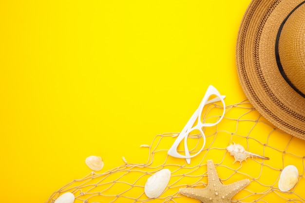 Beach accessories with copy space on yellow background