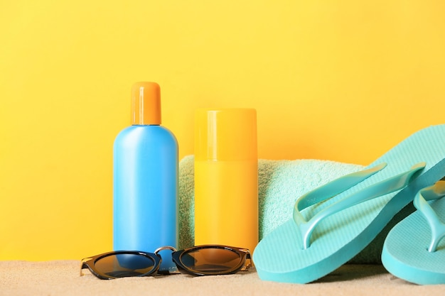 Beach accessories with sunscreen cream on color