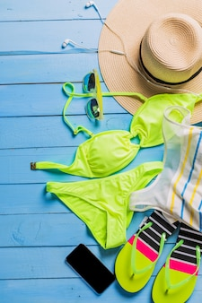 Beach accessories with yellow swimming suit